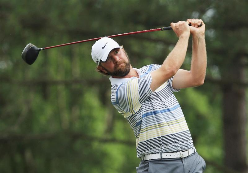 CHARLOTTE, NC - MAY 08:  Lucas Glover watches his tee his shot on the 18th hole during the final round of the Wells Fargo Championship at the Quail Hollow Club on May 8, 2011 in Charlotte, North Carolina.  (Photo by Streeter Lecka/Getty Images)