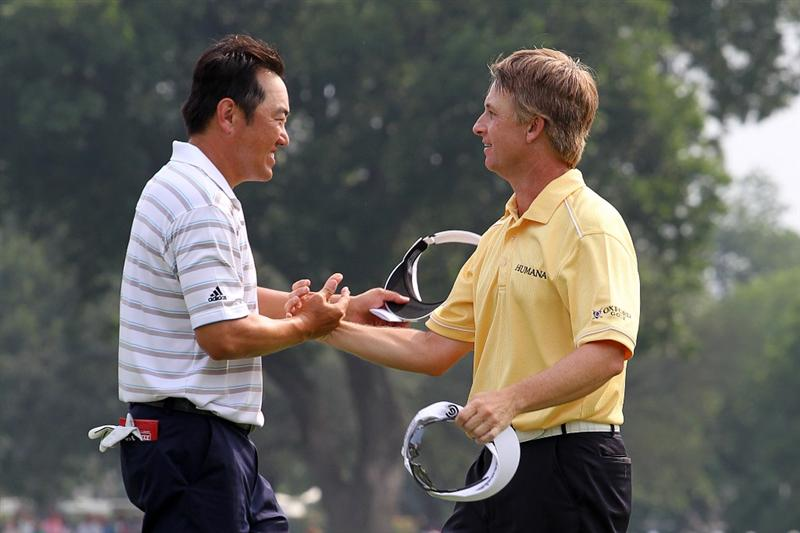 FORT WORTH, TX - MAY 22: David Toms (R) shakes hands with Charlie Wi on the 18th green after winning the Crowne Plaza Invitational at Colonial Country Club on May 22, 2011 in Fort Worth, Texas. (Photo by Hunter Martin/Getty Images)