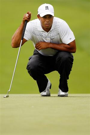 GRAND BLANC, MI - AUGUST 01:  Tiger Woods lines up a putt on the 3rd hole during round three of the Buick Open at Warwick Hills Golf and Country Club on August 1, 2009 in Grand Blanc, Michigan.  (Photo by Chris Graythen/Getty Images)