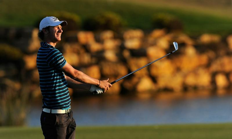 FARO, PORTUGAL - OCTOBER 14:  Chris Wood of England plays his approach shot on the 18th hole during the first round of the Portugal Masters at the Oceanico Victoria Golf Course on October 14, 2010 in Faro, Portugal.  (Photo by Stuart Franklin/Getty Images)