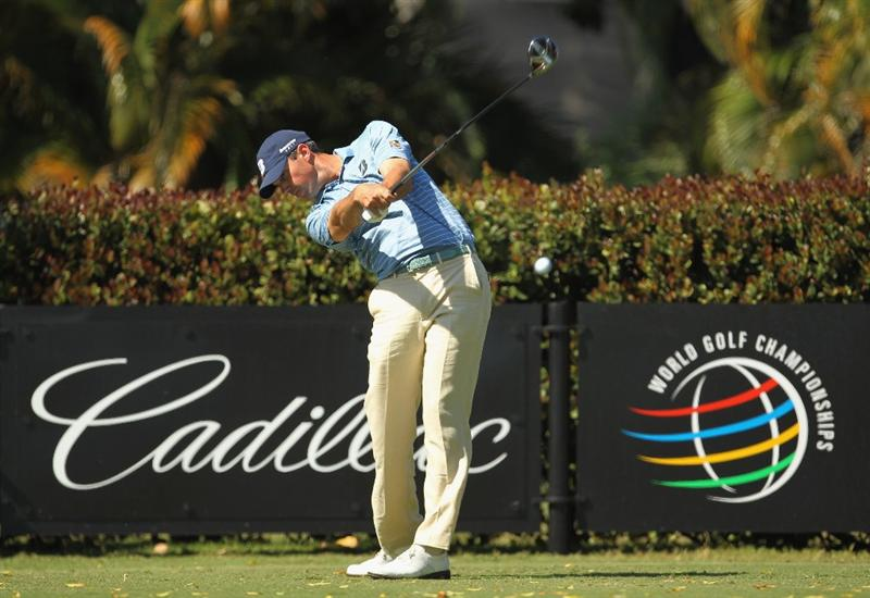 DORAL, FL - MARCH 13:  Matt Kuchar hits his tee shot on the sixth hole during the final round of the 2011 WGC- Cadillac Championship at the TPC Blue Monster at the Doral Golf Resort and Spa on March 13, 2011 in Doral, Florida.  (Photo by Mike Ehrmann/Getty Images)