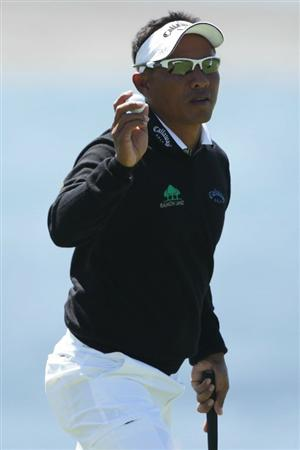PEBBLE BEACH, CA - JUNE 17:  Thongchai Jaidee of Thailand waves to the gallery on the 18th green during the first round of the 110th U.S. Open at Pebble Beach Golf Links on June 17, 2010 in Pebble Beach, California.  (Photo by Andrew Redington/Getty Images)