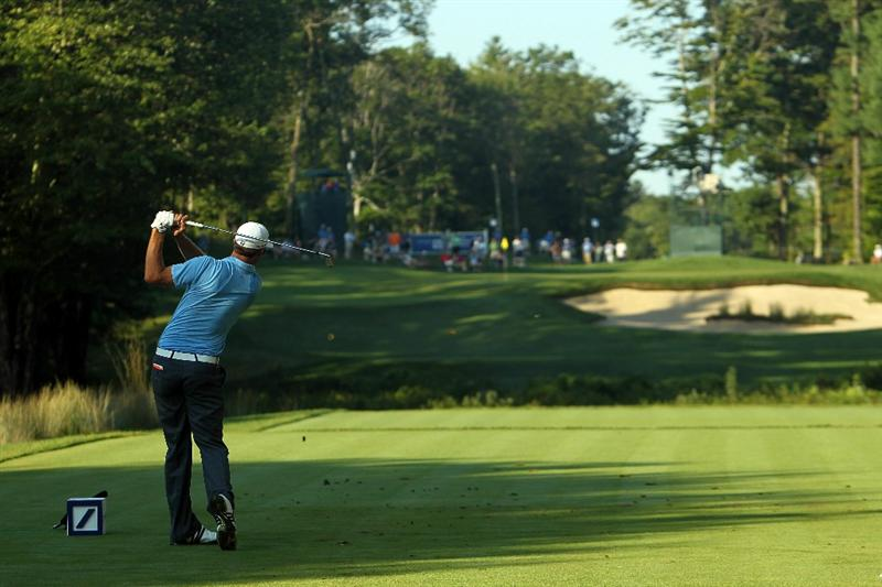 NORTON, MA - SEPTEMBER 04:  Dustin Johnson hits a shot on the 11th tee during the second round of the Deutsche Bank Championship at TPC Boston on September 4, 2010 in Norton, Massachusetts.  (Photo by Mike Ehrmann/Getty Images)