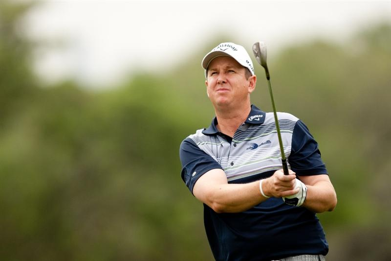 SAN ANTONIO, TX - APRIL 14: J.J. Henry follows through on an approach shot during the first round of the Valero Texas Open at the AT&T Oaks Course at TPC San Antonio on April 14, 2011 in San Antonio, Texas. (Photo by Darren Carroll/Getty Images)