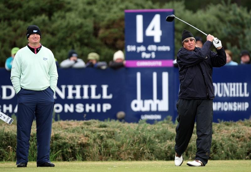 CARNOUSTIE, UNITED KINGDOM - OCTOBER 04:  Ernie Els of South watches his father Neels Els drive off the 14th tee during the third round of The Alfred Dunhill Links Championship at Carnoustie Golf Club on October 4, 2008 in Carnoustie, Scotland.  (Photo by David Cannon/Getty Images)