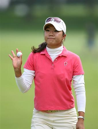 CLIFTON, NJ - MAY 16 : Ji Young Oh of South Korea waves to the spectators on the 18th hole during the third round of the Sybase Classic presented by ShopRite at Upper Montclair Country Club on May 16, 2009 in Clifton, New Jersey. (Photo by Hunter Martin/Getty Images)