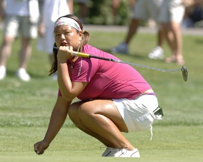 Christina Kim looks for a birdie on the second green during the final round of the Safeway Classic at Columbia-Edgewater Country Club in Portland, Oregon on August 20, 2006.Photo by Al Messerschmidt/WireImage.com