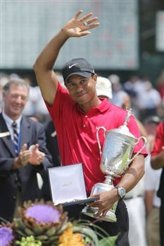 SAN DIEGO - JUNE 16:  Tiger Woods celebrates with the trophy after winning on the first sudden death playoff hole during the playoff round of the 108th U.S. Open at the Torrey Pines Golf Course (South Course) on June 16, 2008 in San Diego, California.  (Photo by Doug Pensinger/Getty Images)