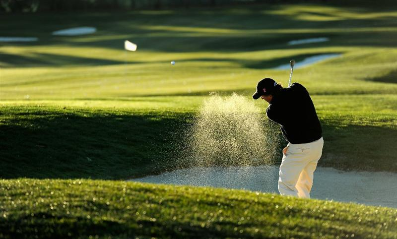 PEBBLE BEACH, CA - FEBRUARY 10:  Phil Mickelson plays a bunker shot during the first round of the AT&T Pebble Beach National Pro-Am at Monterey Peninsula Country Club on February 10, 2011  in Pebble Beach, California.  (Photo by Stuart Franklin/Getty Images)