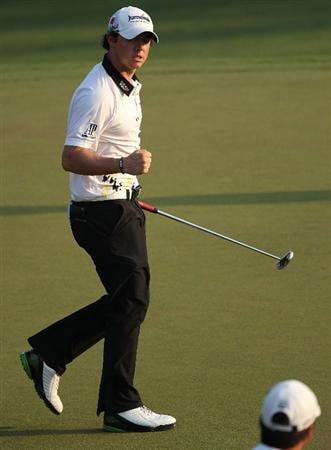 AUGUSTA, GA - APRIL 09:  Rory McIlroy of Northern Ireland reacts to his birdie putt on the 17th green during the third round of the 2011 Masters Tournament at Augusta National Golf Club on April 9, 2011 in Augusta, Georgia.  (Photo by Andrew Redington/Getty Images)