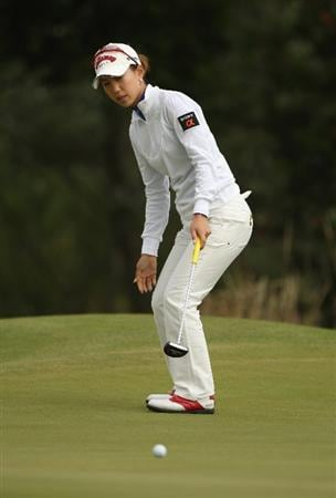 LYTHAM ST ANNES, ENGLAND - JULY 31:  Momoko Ueda of Japan reacts to a putt during the second round of the 2009 Ricoh Women's British Open Championship held at Royal Lytham St Annes Golf Club, on July 31, 2009 in  Lytham St Annes, England.  (Photo by Warren Little/Getty Images)