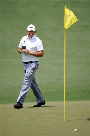 AUGUSTA, GA - APRIL 09:  Phil Mickelson walks across the second green during the third round of the 2011 Masters Tournament at Augusta National Golf Club on April 9, 2011 in Augusta, Georgia.  (Photo by Harry How/Getty Images)