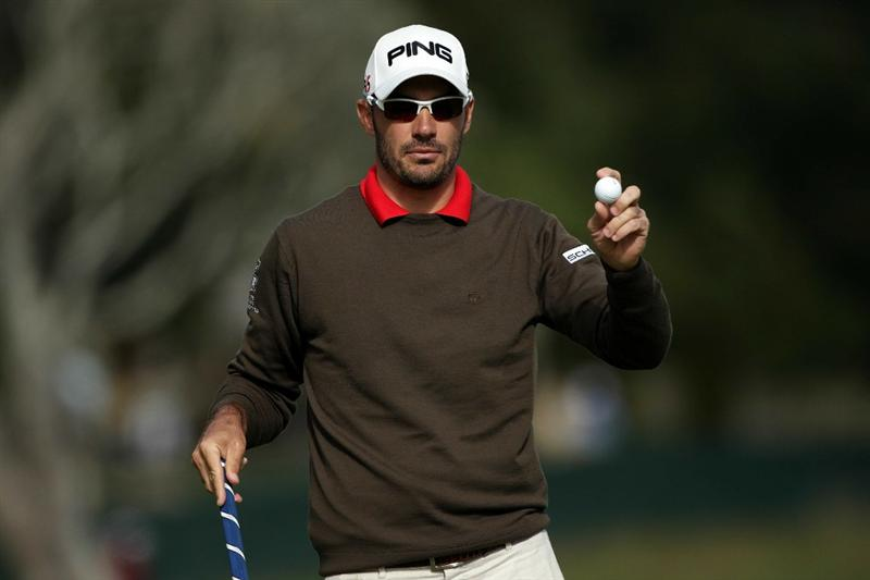 PEBBLE BEACH, CA - JUNE 19:  Gregory Havret of France celebrates on the 12h hole during the third round of the 110th U.S. Open at Pebble Beach Golf Links on June 19, 2010 in Pebble Beach, California.  (Photo by Andrew Redington/Getty Images)