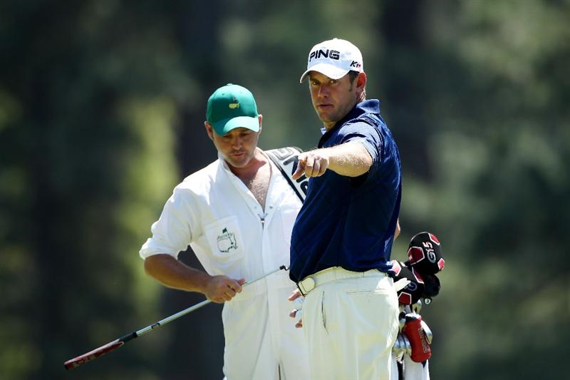 AUGUSTA, GA - APRIL 04:  Lee Westwood of England (R) chats with his caddie Billy Foster during a practice round prior to the 2011 Masters Tournament at Augusta National Golf Club on April 4, 2011 in Augusta, Georgia.  (Photo by Andrew Redington/Getty Images)