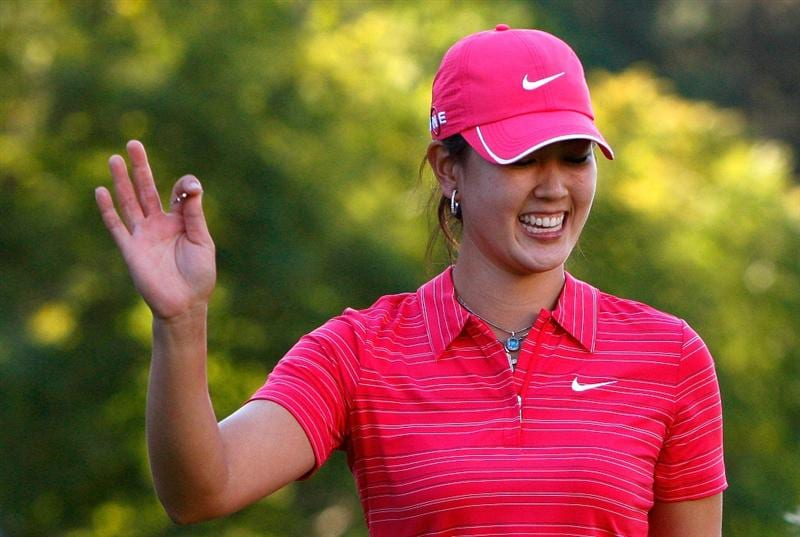 GUADALAJARA, MEXICO - NOVEMBER 15:  Michelle Wie of the United States reacts after hitting out of the sand onto the 18th green during the final round of the Lorena Ochoa Invitational Presented by Banamex and Corona at Guadalajara Country Club on November 15, 2009 in Guadalajara, Mexico.  (Photo by Kevin C. Cox/Getty Images)