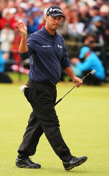 CARNOUSTIE, UNITED KINGDOM - JULY 22:  Chris DiMarco of the USA waves to the gallery as he walks off the 18th hole during the final round of The 136th Open Championship at the Carnoustie Golf Club on July 22, 2007 in Carnoustie, Scotland.  (Photo by Andrew Redington/Getty Images)