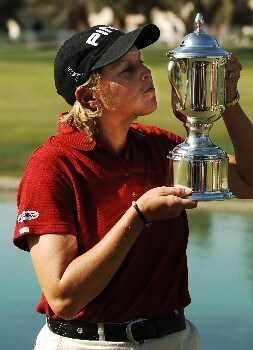 Wendy Ward kisses the winner's trophy on the 18th green after winning the 2005 LPGA Takefuji Classic at the Las Vegas Country Club in Las Vegas, Nevada, April 16, 2005.Photo by Steve Grayson/WireImage.com