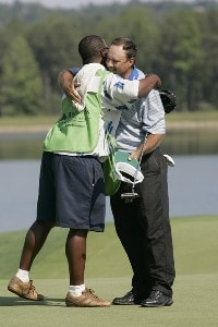 Brad Bryant hugs his caddie Tony Smith after making a par to force a playoff during the third and final round of the Regions Charity Classic at the  Robert Trent Jones Golf Trail at Ross Bridge in Hoover, Alabama on May 20, 2007. Champions Tour - 2007 Regions Charity Classic - Final RoundPhoto by Michael Cohen/WireImage.com