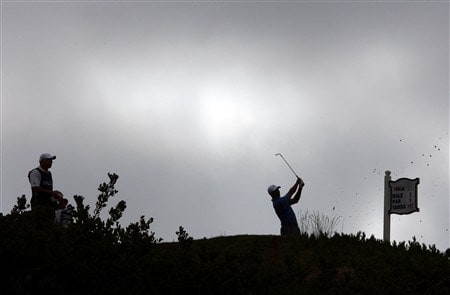 SAN DIEGO - JUNE 12:  Tiger Woods hits his tee shot on the third hole during the first round of the 108th U.S. Open at the Torrey Pines Golf Course (South Course) on June 12, 2008 in San Diego, California.  (Photo by Ross Kinnaird/Getty Images)