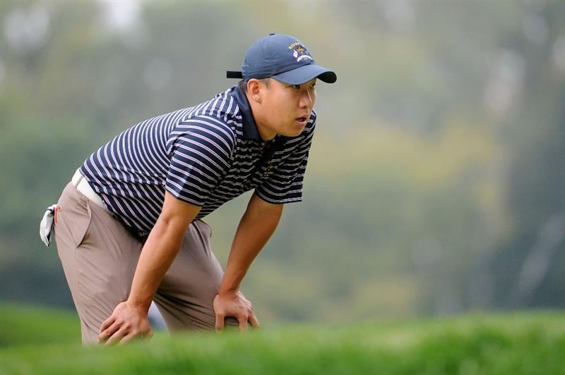 LOUISVILLE, KY - SEPTEMBER 20:  Anthony Kim of the USA team watches the play on the tenth green during the morning foursome matches on day two of the 2008 Ryder Cup at Valhalla Golf Club on September 20, 2008 in Louisville, Kentucky.  (Photo by Harry How/Getty Images)
