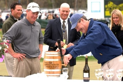 Phil Wente pours Tripp Isenhour a glass of wine from the winner's trophy after Isenhour's victory in the Nationwide's TOUR 2006 Livermore Valley Wine Country Championship at The Course at Wente Vineyards in Livermore, California April 2, 2006.Photo by Steve Grayson/WireImage.com