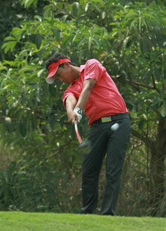 CHON BURI, THAILAND - FEBRUARY 24: Choengchai Panpumpo of Thailand plays his tee shot on the 9th hole during day one of The Open Championship Asia Final Qualifying tournament at Amata Spring Country Club on February 24, 2011 in Chon Buri, Thailand.  (Photo by Stanley Chou/Getty Images)