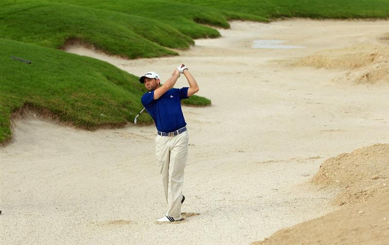 BAHRAIN, BAHRAIN - JANUARY 26:  Sergio Garcia of Spain plays his second shot on the 18th hole during the Pro Am prior to the start of the Volvo Golf Champions at The Royal Golf Club on January 26, 2011 in Bahrain, Bahrain.  (Photo by Andrew Redington/Getty Images)
