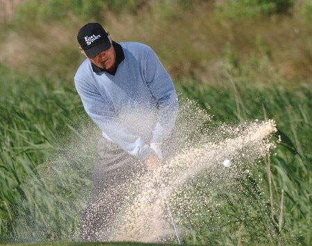 John Jacobs follows through from a fairway bunker on the fourth hole  during the final  round of    the 2005 Liberty Mutual Legends of Golf tournament, April 24, in Savannah.Photo by Al Messerschmidt/WireImage.com