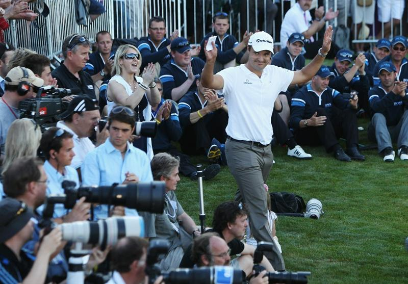 VIRGINIA WATER, ENGLAND - MAY 23:  Simon Khan of England celebrates as he steps forward to accept the trophy following his victory in the BMW PGA Championship on the West Course at Wentworth on May 23, 2010 in Virginia Water, England.  (Photo by Ian Walton/Getty Images)