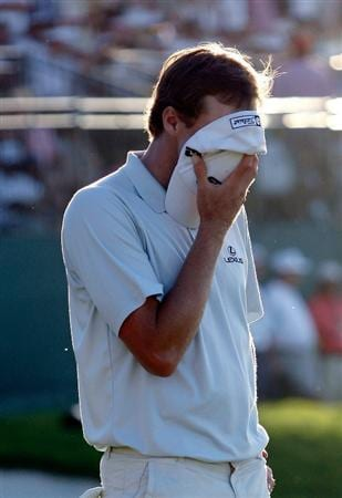 DORAL, FL - MARCH 15:  Nick Watney covers his face after missing a putt for birdie on the 18th hole during the final round of the World Golf Championships-CA Championship on March 15, 2009 at the Doral Golf Resort and Spa in Doral, Florida.  (Photo by Jamie Squire/Getty Images)