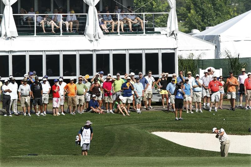 MEMPHIS, TN - JUNE 12: Larges crowds of fans watch as Lee Janzen of the United States hits his second shot on the 18th fairway during the third round of the St. Jude Classic at TPC Southwind held on June 12, 2010 in Memphis, Tennessee.  (Photo by John Sommers II/Getty Images)