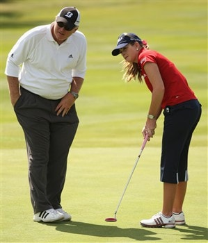 SUNNINGDALE, UNITED KINGDOM - JULY 30:  Paula Creamer of the USA putts on the 17th green watched by her father Paul Creamer during practice for the 2008 Ricoh Women's British Open at Sunningdale Golf Club on July 30, 2008 in Sunningdale, England.  (Photo by Warren Little/Getty Images)