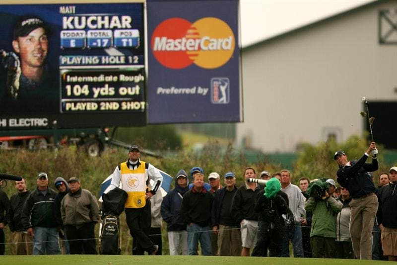 VERONA, NY - OCTOBER 05:  Matt Kuchar plays a shot on the 12th hole during a six hole play-off against Vaughn Taylor at the 2009 Turning Stone Resort Championship at Atunyote Golf Club held on October 5, 2009 in Verona, New York.  (Photo by Chris Trotman/Getty Images)