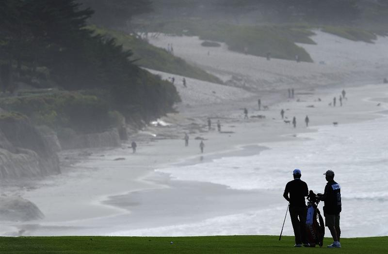 PEBBLE BEACH, CA - FEBRUARY 12:  Tim Clarke of South Africa and caddie on the nineth hole during round two of the AT&T Pebble Beach National Pro-Am at Pebble Beach Golf Links on February 12, 2010 in Pebble Beach, California.  (Photo by Stuart Franklin/Getty Images)