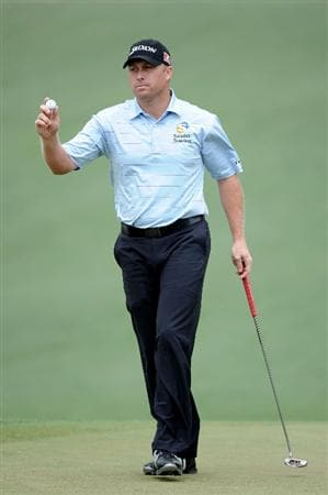 AUGUSTA, GA - APRIL 08:  John Rollins waves to the gallery on the second green during the first round of the 2010 Masters Tournament at Augusta National Golf Club on April 8, 2010 in Augusta, Georgia.  (Photo by Harry How/Getty Images)