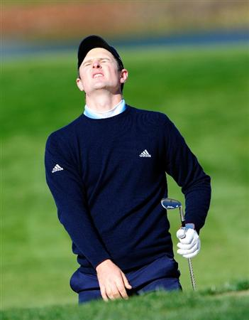 PALM BEACH GARDENS, FL - MARCH 04:  Justin Rose of England reacts to a shot on the 8th hole during the first round of the Honda Classic at PGA National Resort And Spa on March 4, 2010 in Palm Beach Gardens, Florida.  (Photo by Sam Greenwood/Getty Images)