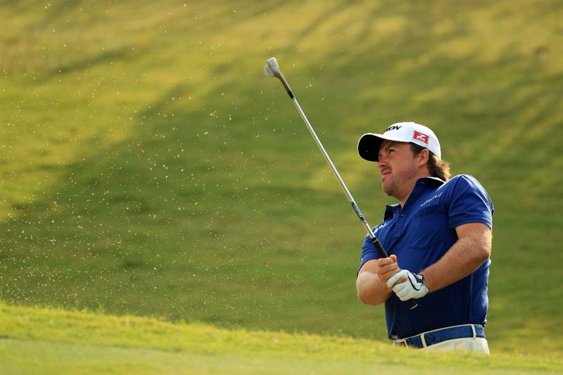 PONTE VEDRA BEACH, FL - MAY 14:  Graeme McDowell of Northern Ireland hits a shot on the pratcice ground during the third round of THE PLAYERS Championship held at THE PLAYERS Stadium course at TPC Sawgrass on May 14, 2011 in Ponte Vedra Beach, Florida.  (Photo by Streeter Lecka/Getty Images)
