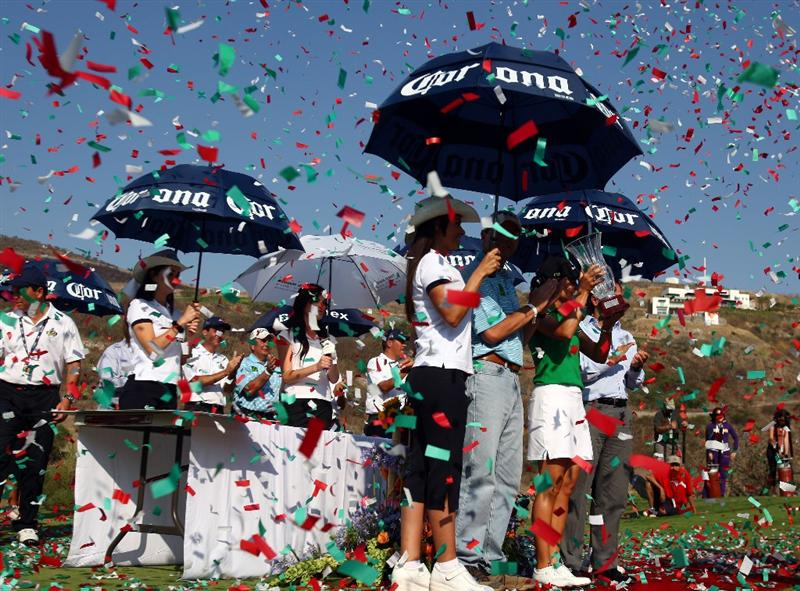 MORELIA, MEXICO- APRIL 26:  Lorena Ochoa of Mexico accepts the winner's trophy after her 25-under par victory during the final round of the Corona Championship at the Tres Marias Residential Golf Club on April 26, 2009 in Morelia, Michoacan, Mexico. (Photo by Donald Miralle/Getty Images)