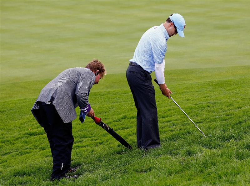 NEWPORT, WALES - OCTOBER 03:  Zach Johnson of the USA consults with an official during the  Fourball & Foursome Matches during the 2010 Ryder Cup at the Celtic Manor Resort on October 3, 2010 in Newport, Wales. (Photo by Sam Greenwood/Getty Images)