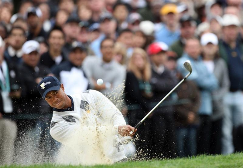 SAN FRANCISCO - OCTOBER 10:  Tiger Woods of the USA plays his third shot at the 8th hole during the Day Three Afternoon Fourball Matches in The Presidents Cup at Harding Park Golf Course on October 10, 2009 in San Francisco, California  (Photo by David Cannon/Getty Images)