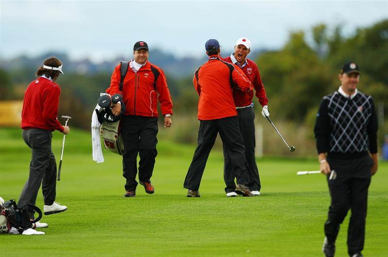 NEWPORT, WALES - OCTOBER 03:  Jeff Overton (R) of the USA celebrates after holing out for an eagle on the 8th hole during the  Fourball & Foursome Matches during the 2010 Ryder Cup at the Celtic Manor Resort on October 3, 2010 in Newport, Wales.  (Photo by Richard Heathcote/Getty Images)