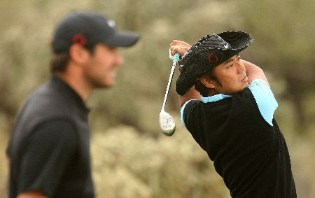 MARANA, AZ - FEBRUARY 20:  Shingo Katayama of Japan watches his tee shot on the third hole as Trevor Immelman of South Africa looks on during the first-round matches of the WGC-Accenture Match Play Championship at The Gallery Golf Club at Dove Mountain on February 20, 2008 in Marana, Arizona.  (Photo by Scott Halleran/Getty Images)