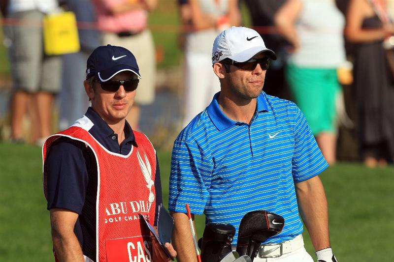 ABU DHABI, UNITED ARAB EMIRATES - JANUARY 22:  Paul Casey of England with his caddie Christian Donald before he played his second shot at the par 4, 16th hole during the second round of The Abu Dhabi Golf Championship at Abu Dhabi Golf Club on January 22, 2010 in Abu Dhabi, United Arab Emirates.  (Photo by David Cannon/Getty Images)