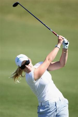 PHOENIX - MARCH 28:  Morgan Pressel hits her second shot on the 12th hole during the third round of the J Golf Phoenix LPGA International golf tournament at Papago Golf Course on March 28, 2009 in Phoenix, Arizona.  (Photo by Christian Petersen/Getty Images)