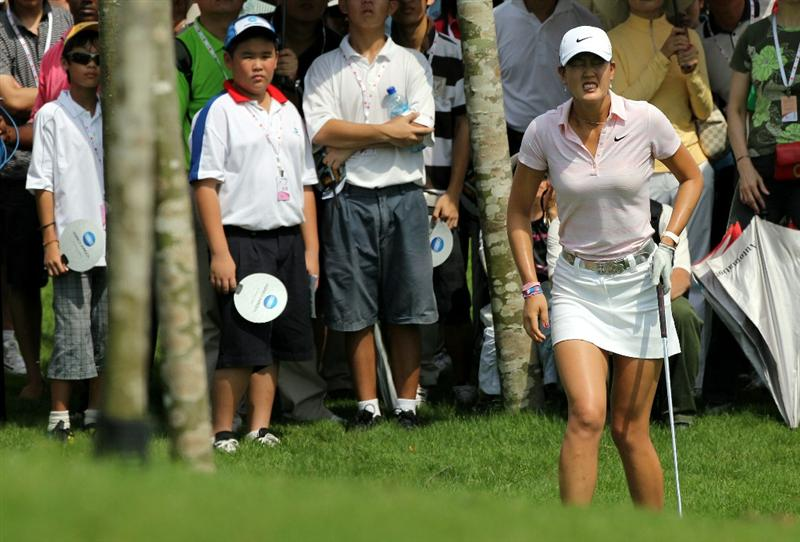 KUALA LUMPUR, MALAYSIA - OCTOBER 23 : Michelle Wie of USA in pain after hitting her 2nd shot out of the rough on the 3rd hole during Round Two of the Sime Darby LPGA on October 23, 2010 at the Kuala Lumpur Golf and Country Club in Kuala Lumpur, Malaysia. (Photo by Stanley Chou/Getty Images)