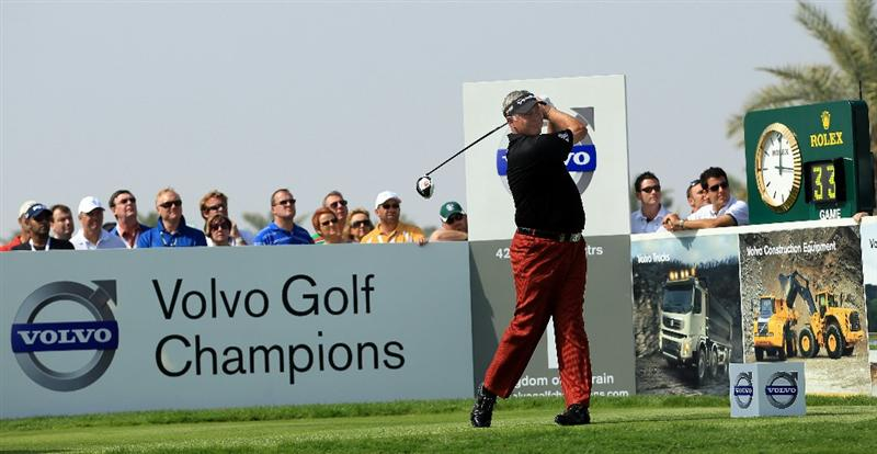BAHRAIN, BAHRAIN - JANUARY 30:  Darren Clarke of Northern Ireland tees off on the first hole during the final round of the Volvo Golf Champions at The Royal Golf Club on January 30, 2011 in Bahrain, Bahrain.  (Photo by Andrew Redington/Getty Images)
