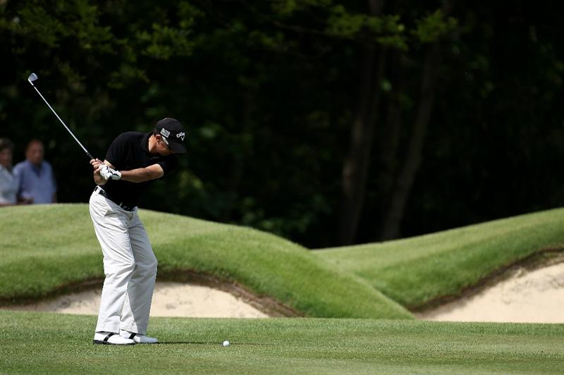 VIRGINIA WATER, ENGLAND - MAY 21:  Francois Delamontagne of France hits his approach shot on the 1st hole during the second round of the BMW PGA Championship on the West Course at Wentworth on May 21, 2010 in Virginia Water, England.  (Photo by Ross Kinnaird/Getty Images)