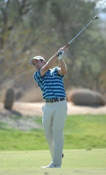 SCOTTSDALE, AZ - OCTOBER 20: Mark Hensby hits his approach shot into the 10th hole during the third round of the Fry's Electronics Open on October 20, 2007 at the Grayhawk Golf Club in Scottsdale, Arizona  (Photo by Marc Feldman/Getty Images)