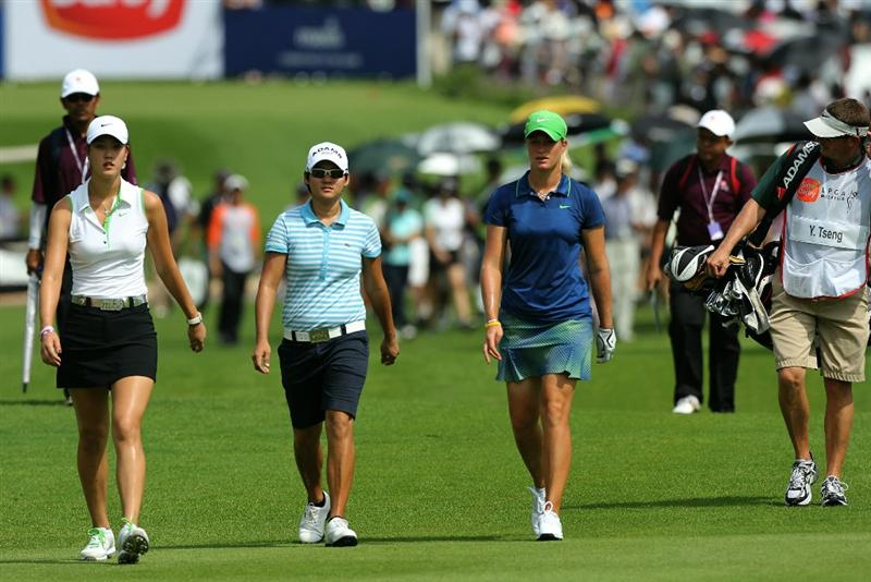 KUALA LUMPUR, MALAYSIA - OCTOBER 22:  Michelle Wie of USA, Yani Tseng of Taiwan and Suzann Pettersen of Norway walk towards the 1st hole during Round One of the Sime Darby LPGA on October 22, 2010 at the Kuala Lumpur Golf and Country Club in Kuala Lumpur, Malaysia. (Photo by Stanley Chou/Getty Images)