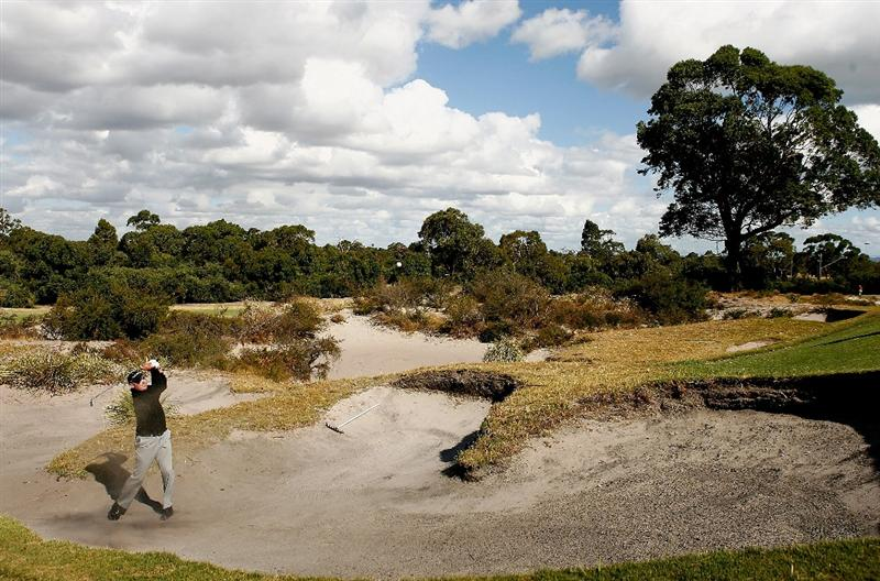 MELBOURNE, AUSTRALIA - FEBRUARY 10:  Michael Brennan of Australia plays out of the bunker on the fifteenth hole during the Australasia International Final Qualifying for The 2009 Open Championship at Kingston Heath Golf Club on February 10, 2009 in Melbourne, Australia.  (Photo by Quinn Rooney/Getty Images)